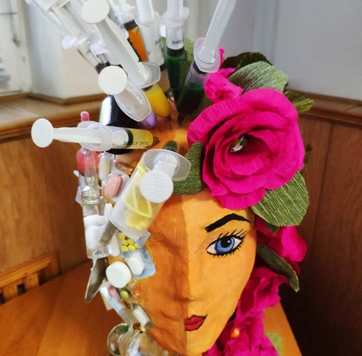 Artwork of women head with syringes