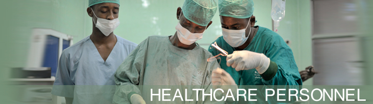 Surgeons stitch up a patient after an operation at Banadir hospital in Mogadishu, Somalia; Photo: Tobin Jones