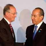"Photo: UNODC: UNODC Executive Director Antonio Maria Costa (left) with Mexican President Felipe Calderón Hinojosa, at the launch of the Mexico ""Blue Heart""campaign against human trafficking, in Mexico City"