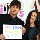 "Photo: Ashton Kutcher & Demi Moore - Poster Slogan ""Real Men don't Buy Girls"""