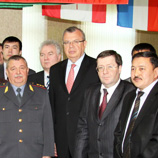 Photo: UNODC Executive Director Yury Fedotov (centre) with officials from the Domodedovo Training Centre in Moscow