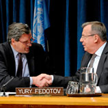 UN Photo/Evan Schneider: Alain Le Roy (left) and Yury Fedotov shake hands after signing pact to fight organized crime in conflict areas