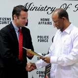 Photo: UNODC Regional Manager for the Container Control Programme (Latin America and the Caribbean), Troels Vester (left) with Guyanese Minister for Home Affairs, Hon. Clement Rohee at the signing ceremony in Georgetown