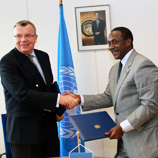Photo: UNIDO Director-General Kandeh K. Yumkella (right) shakes hands with UNODC Executive Director Yury Fedotov at the signing ceremony
