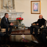 Photo: UNAMA/Eric Kanalstein: UNODC Executive Director Yury Fedotov (left) meets with Afghanistan President Hamid Karzai in Kabul