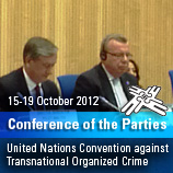 Photo: UNODC/Executive Director of UNODC Yury Fedotov (right) addesses the opening of the 6th Session of the Conference of Parties for the UN Convention against Transnational Organized Crime. On the left is President Danilo Türk of Slovenia.