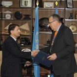 UNWTO Secretary-General, Taleb Rifai (left), and UNODC Executive Director, Yury Fedotov (right) at the signing of a new Cooperation Agreement between the two organizations.