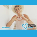 Serinda Swan, from USA Network's Graceland, supports UNODC's Blue Heart Campaign making the hand heart.