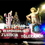 Panama City Christmas parade. Participants, especially children, cheered Dogui and Dengoso, the cartoon characters who promote the Anti-Corruption Values Programme in the country. Photo: UNODC.