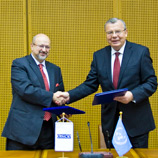 OSCE Secretary General Lamberto Zannier (left) and UNODC Executive Director Yury Fedotov (right) following the signing of a new Joint Plan of Action