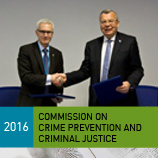 The Chiefs of UNODC and INTERPOL sign cooperation arrangement during the 2016 Crime Commission. Photo: UNODC